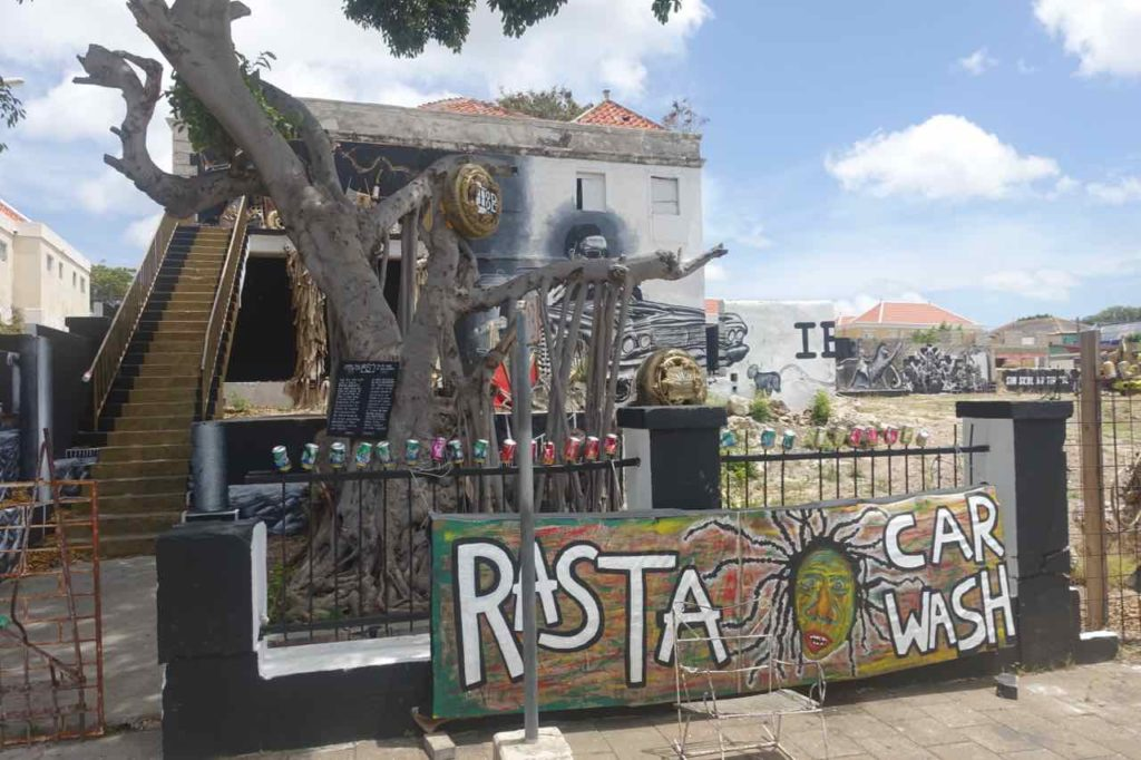 "Street Art in Curacao, Willemstad-Otrobanda Infotafel zu ""Rasta Car Wash"" Copyright Peter Pohle PetersTravel"