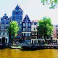Amsterdam Kurztrip: Gracht mit Häusern, Titelbild Copyright Peter Pohle Peterstravel